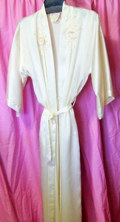 Luxurious quality liquid charmeuse satin. Kimono wrap style, inside ties, outside belted closure. Lovely applique embroidery accents on front.  Marked a Size US Size Small  Excellent - if worn would be so gently, – no flaws or issues to state  Details  Bust: approx 44 fully closed  Length underarm seam to hem: 45 (this measurement is the most accurate of where the item will hit on body)  Total Length approx 55  Label California Dynasty Fabric charmeuse satin Care washable  All Items are…