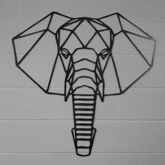 This is a solid steel geometric elephant wall art that is hand finished so that each piece is unique. It is made from 3mm mild steel here in the UK. This would make a lovely gift for any number of occassions. It comes in a number of sizes so that it will fit beautifully in a number