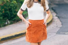 Waisted suede skirt and knit ribbed top with dainty gold jewelry