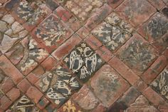 Heraldic tiled floor at Cleeve Abbey, UK, 13th century.