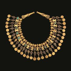 A first century collar necklace from a tomb in Tillia Tepe, Afghanistan. Photo by Thierry Ollivier/Muse Guimet/Getty Images. Ancient Jewelry Photo Gallery - First Century Collar Necklace - Pictures of Ancient Jewelry Tribal Jewelry, Jewelry Art, Antique Jewelry, Vintage Jewelry, Fine Jewelry, Jewelry Design, Jewelry Making, Egypt Jewelry, Silver Jewelry
