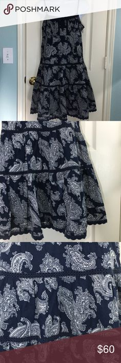 Juicy Couture BoHo Mini Tiered Paisley Voile Dress Women's Juicy Couture BoHo Mini Tiered Voile Dress. Navy Blue and White Paisley design with crocheted accents at the bodice and hem. Fully lined, side zipper. 100% Cotton.  Gently used condition. No stains, tears, or holes. No fading. See pictures for details.  All measurements are taken with item laying flat.  Measurements: Chest (underarm to underarm)-  16 inches Length (back neck seam to bottom)- 25 inches 📦📦 Fast Shipping!! I strive…
