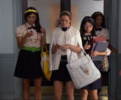 Blair Waldorf flanked by her minions Penelope Shafai, Nelly Yuki, and Isabel Coates in the hallways of their school Constance Billard........