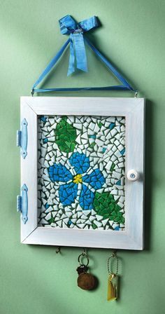 Mosaic Flower Key Holder - Crafts n things - Made from an old frame, ribbon and broken tile and grout.