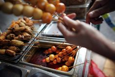 https://flic.kr/p/7aNMmm | Chinese Food Cart 04 |  Linda cooks fish ball kebabs in chili oil at Linda's Mini Kitchen in Brooklyn.  East side of Eighth Avenue between 57th and 58th Streets, Sunset Park, Brooklyn, (917).405-6375; morning to 8:30 p.m.  www.nytimes.com/2009/10/21/dining/reviews/21under.html?_r=1