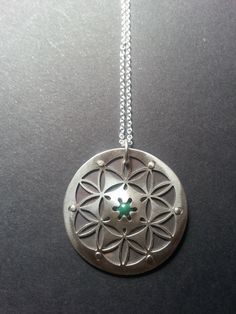 Silver and Malachite Flower of Life Pendant - Handcrafted Sacred Geometry Jewellery by JeanBurgersJewellery on Etsy https://www.etsy.com/listing/172715508/silver-and-malachite-flower-of-life