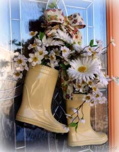 "Unique spring arrangement using a pair of children's rain boots.  The designer said, ""Some people put ice skates on their door at Christmas time—so I thought, ""Why not rain boots for Spring?"""