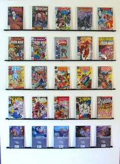 DIY comic book wall display. Just used the wall mount for wire closet organization from Lowes. Painted it black and used screws to secure it into the wall!