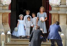 Young flower girls and ushers pose
