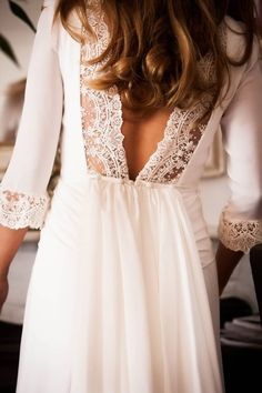 Pretty lace & low back. This would make a lovely wedding dress too :-)