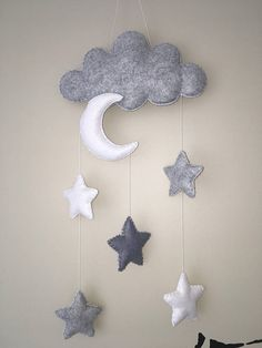 Gorgeous gray nursery decor. This is a gender neutral monochrome mobile, cot mobile, wall hanging or door decor. It can be a charming baby shower gift or decoration. lt makes a perfect christmas gift for baby. Lovely fluffy cloud with moon and 5 puffy stars It is made with a loop for