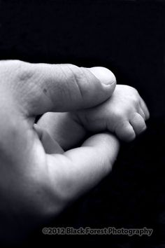 Close up of dad and baby's hands in black and white by Colorado Springs Infant and baby photographer Black Forest Photography http://www.blackforestphoto.com