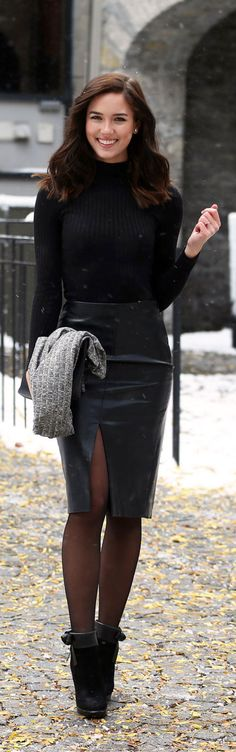 Fashion blogger Marie's Bazaar wears this simple and affordable all-black outfit for the holidays. This gorgeous simple leather skirt by Aritzia is such a dream, paired perfectly with a thin black turtleneck from Dynamite Clothing and grab a cozy grey cardigan to stay warm!