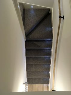 A double winder flight of stairs complete MDF treads and softwood winders that have been carpeted. The rope handrail was sourced elsewhere by our customer.