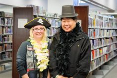 Library volunteers enjoy dressing up for the self-serve photo book during our centennial day.