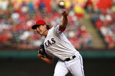 ARLINGTON, TX - APRIL 07:  Derek Holland #45 of the Texas Rangers throws against the Chicago White Sox at Rangers Ballpark in Arlington on April 7, 2012 in Arlington, Texas.  (Photo by Ronald Martinez/Getty Images) Game 2