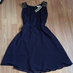 Esley navy beaded dress NWT Esley brand dress (featured at stores like mod cloth!) featuring pewter beadwork on the shoulders, a bow detail at the waist and an exposed zipper on the back. NWT, perfect for a date night or a special event! Esley Dresses Mini