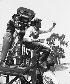 Orson Welles directs a scene from Citizen Kane on location in Hollywood in July 1940, with cinematographer Gregg Toland handling the camera.