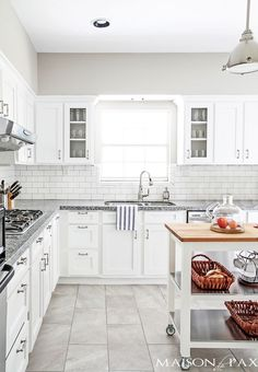 White kitchen with subway tile and gray granite | maisondepax.com