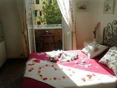 Red romantic apartment rome balcony bedroom petals roses towel pillows flowers info@moustachehouse.it