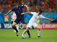 Stefan de Vrij of the Netherlands challenges David Silva of Spain during the 2014 FIFA World Cup Brazil Group B match between Spain and Netherlands at Arena Fonte Nova on June 13, 2014 in Salvador, Brazil.