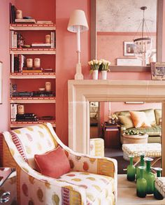 A pink hue in the living room from Domino magazine. What a great idea to mirror a non-working fireplace as well!