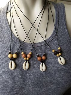 Cowrie shell with wooden beads in various sizes and colors. A cute beachy, boho, hippie, gypsy chic style necklace. Wear alone or layer with other necklaces for a trendy layered look.