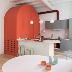 @colomboserboli has made room for colourful storage units and a pink bathroom by opening up the plan of this apartment in Barcelona's historic El Born neighbourhood.  See more images on dezeen.com/interiors  #Interiors #Barcelona #Pink  Photograph by @roberto_ruiz_photography