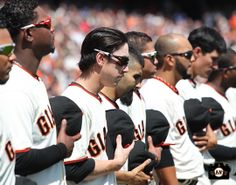 The Giants lineup together along the 3rd baseline for the National Anthem on April 8, 2014.