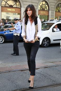 Emmanuelle Alt Street Style Pictures   White blouse, rolled sleeves,  Vest, black wedge(?) heels, straight black jeans, rolled at the bottom.