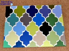 Paint Chip Quatrefoil Art. Made with paint chips but could also do this with wallpaper samples or left over scrapbook paper. NEAT!