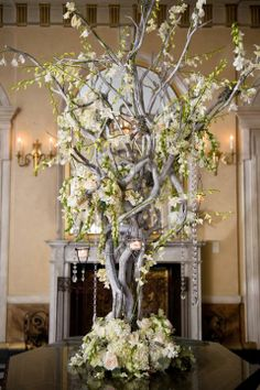Create a stunning entryway. Decorate a Manzanita tree with flowers and hanging candles and place it right outside the reception hall.
