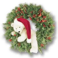 Wreath covered in greenery and berries or whatever Christmas decorations you like and a winter polar bear in the center perfect for my hubby