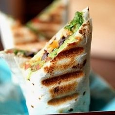 Grilled black bean, chicken, and avocado burrito.