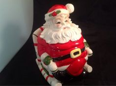 Lefton Rocking Santa Cookie Jar. I have this but his suit is white like they forgot to paint it. It is my favorite.