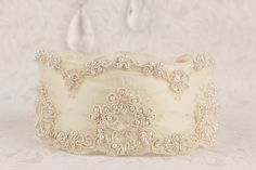 Regal Elegance Couture  Cream & Ivory Regal heirloom beaded lace on satin.  Comes with a toss garter.