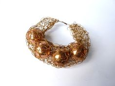 Copper Net Bracelet by CYNAMONN - Organic Contemporary jewelry;  http://www.etsy.com/shop/Cynamonn?ref=seller_info
