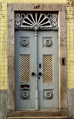 Culture in Porto, Portugal (door building porta) - a photo by josecps