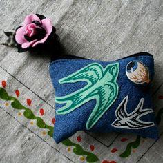 Screen printed swallows on denim purse.