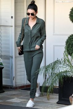 Leaving her dermatologist's office in a green MONROW jumpsuit, white velcro-strap Kenneth Cole sneakers, and a black Saint Laurent bag.