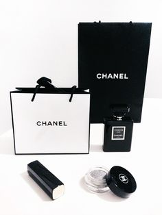Chanel-packages-flatlay-monochrome