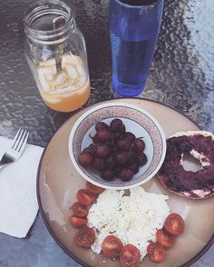 One of my favorite things is to eat breakfast outside and I'm not really sure why 🤗 Today I had 3 scrambled egg whites, cherry tomatoes sprinkled with salt, pepper, & basil, grapes, and half a bagel with blackberry preserves. It was so good!!! Workout ✔️ Breakfast ✔️ Now time to enjoy the sunshine before work 🌻. - - #fitfam #healthy #eatclean #nutrition #focus #passion #fitness #fitchick #health #breakfast #gains #foodisfuel #postworkoutfuel