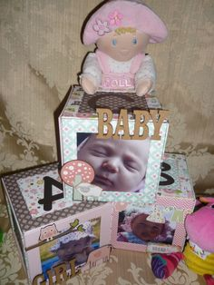 """Baby Blocks"" made entirely from chipboard and covered with DP's from Echo Park. Each of the blocks contains 2 mini albums. If you want to make this then check out https://www.facebook.com/groups/craftyfairygodmothers"