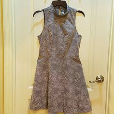 Lauren Conrad Dress Gray with raised rose print. Side zipper and 2 button neck closure.  26 inches from underarm to bottom.  Can be easily hemmed.  Size 8. Lauren Conrad  Dresses