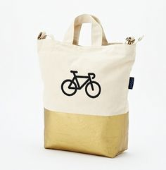NEW from West Elm. Baggu Dipped Tote in metallic gold with bicycle monogram.