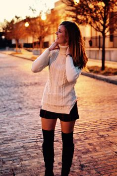 Beige sweater with cowl neck with fall shorts and knee high socks and boots. -Studio 3:19