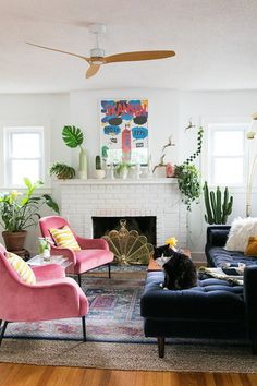 """""""Even when she's messy and """"occupado,"""" this lively living room is lookin' lavish and lovely. Every element is usable, nothing's too presh, AND it tidies up right quick. That's exactly how we like it 'round here."""" Photo by Jessica Brigham. ##SmallSpaceLiving #SmallSpaceDesign"""
