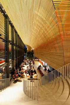 University building in Rotterdam featuring a curving oak interior: http://www.dezeen.com/2014/12/17/powerhouse-company-student-pavilion-erasmus-university-rotterdam/… #architecture
