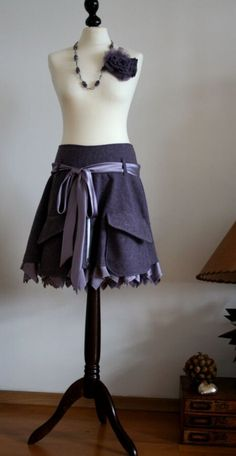 Tweed skirt with cargo pockets and a satin ruffle