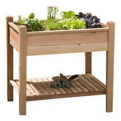 Create a fresh herb garden or display colorful blooms with this red cedar wood planter box, showcasing a slatted lower shelf for added storage. Made in the U...